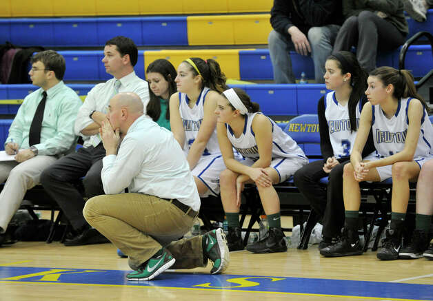 Newtown girls basketball head coach Jeremy O'Connell reacts to a call against Newtown during the Nighthawk's game against Masuk at Newtown High School on Wednesday, Dec. 19, 2012. Wednesday's basketball game was the first sporting event in Newtown since the Sandy Hook Elementary School shooting. Newtown won, 64-44. Photo: Jason Rearick / The News-Times