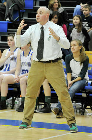 Newtown girls basketball head coach Jeremy O'Connell shouts to his team during the Nighthawk's game against Masuk at Newtown High School on Wednesday, Dec. 19, 2012. Wednesday's basketball game was the first sporting event in Newtown since the Sandy Hook Elementary School shooting. Newtown won, 64-44. Photo: Jason Rearick / The News-Times
