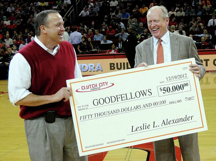 Houston Rockets CEO Tad Brown, left,  gives a $50,000 check for Goodfellows to  Houston Chronicle Chairman Jack Sweeneyat the game Wednesday. Photo: Dave Rossman, Freelance / © 2012 Dave Rossman