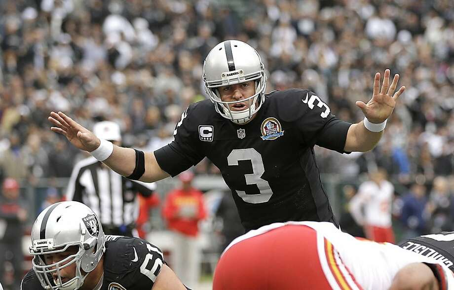 "Raiders quarterback Carson Palmer says adjusting to the new offense has taken time, but ""a second year will do wonders."" Photo: Marcio Jose Sanchez, Associated Press"