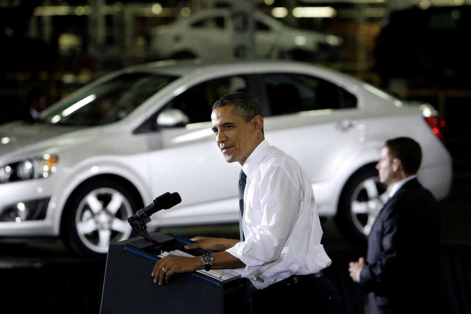 FILE - In this Friday, Oct. 14, 2011, file photo, President Barack Obama speaks at the General Motors Orion assembly plant in Orion Township, Mich. The U.S. government said Wednesday, Dec. 19, 2012, that it will sell its remaining stake in General Motors in the next year or so, winding down a $50 billion bailout that saved the iconic American car giant but also set off a heated debate about government intervention in private business that influenced this year's presidential election. (AP Photo/Carlos Osorio, File) Photo: Carlos Osorio