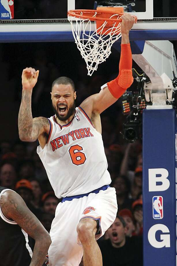 Tyson Chandler hangs around for a celebration after dunking in the Knicks' victory over their crosstown rival, the Nets. Photo: Mary Altaffer, Associated Press