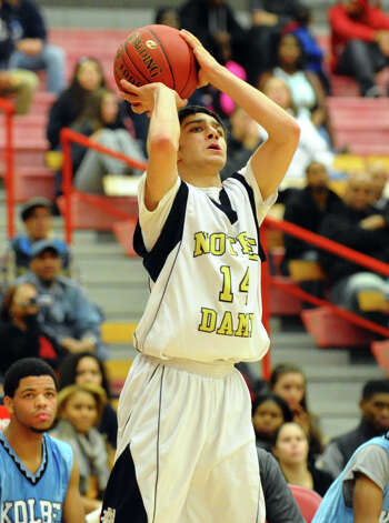 Notre Dame of Fairfield's #14 Joseph Mangiamele attempts a shot, during boys basketball action against Kolbe Cathedral at Sacred Heart University in Fairfield, Conn. on Wednesday December 19, 2012. Photo: Christian Abraham / Connecticut Post