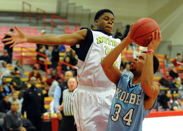 Kolbe Cathedral's #34 Taivon Jones looks for two as Notre Dame of Fairfield's #20 Jaylon Jennings defends the basket, during boys basketball action at Sacred Heart University in Fairfield, Conn. on Wednesday December 19, 2012. Photo: Christian Abraham / Connecticut Post