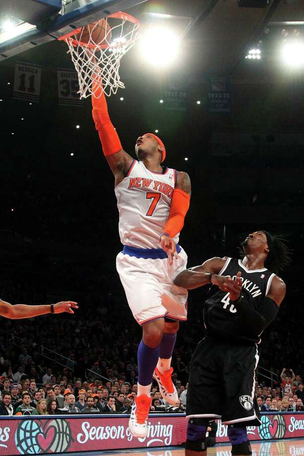 New York Knicks' Carmelo Anthony (7) shoots against Brooklyn Nets' Gerald Wallace during the first half of an NBA basketball game, Wednesday, Dec. 19, 2012, at Madison Square Garden in New York. (AP Photo/Mary Altaffer) Photo: Mary Altaffer