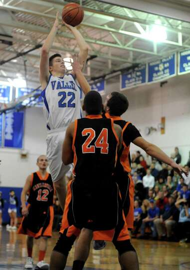 Hoosic Valley's John Rooney goes in for a score during their boy's basketball game against Schuylerv