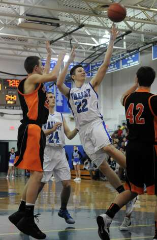 Hoosic Valley's John Rooney takes a shot during their boy's basketball game against Schuylerville in Schaigticoke, NY Wednesday Dec. 19, 2012. (Michael P. Farrell/Times Union) Photo: Michael P. Farrell