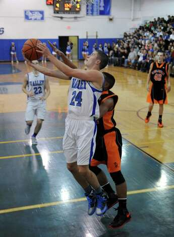 Hoosic Valley's Frank Acker goes in for a score during their boy's basketball game against Schuylerville in Schaigticoke, NY Wednesday Dec. 19, 2012. (Michael P. Farrell/Times Union) Photo: Michael P. Farrell