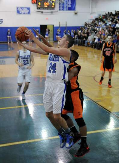 Hoosic Valley's Frank Acker goes in for a score during their boy's basketball game against Schuylerv