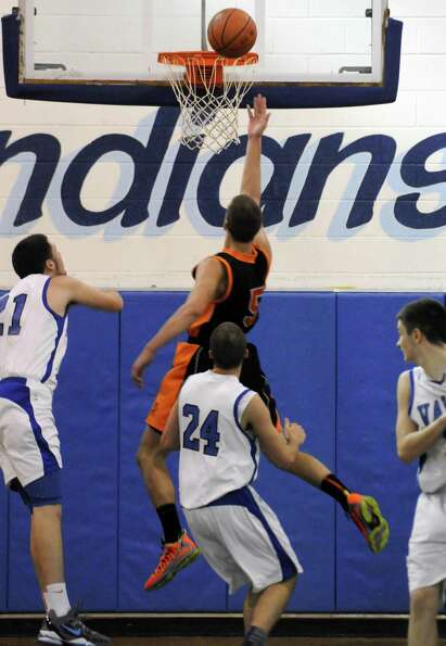 Schuylerville's Shane Lyon goes in for a score during their boy's basketball game against Hoosic Val