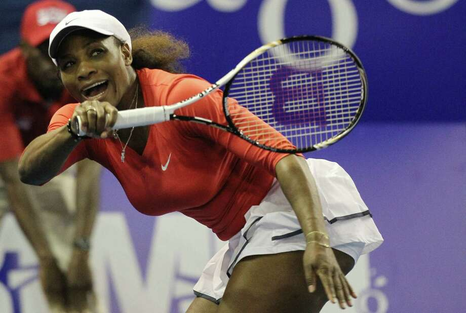 """FILE - In this Nov. 4, 2012, file photo, Serena Williams of the U.S. returns a serve from sister Venus during an exhibition tennis match at Ellis Park Indoor Arena in Johannesburg, South Africa. Williams has had surgery on her big toes and withdrew from an exhibition match against top-ranked Victoria Azarenka in Thailand in December. A medical certificate from Florida podiatrist Jeffrey Rockefeller says Williams """"was treated for a chronic foot disorder which involved minor procedures on both of her great toes."""" (AP Photo/Themba Hadebe, File) Photo: Themba Hadebe"""