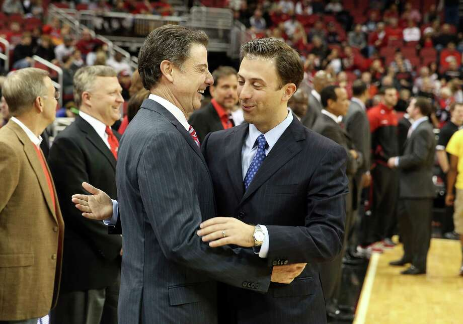 LOUISVILLE, KY - DECEMBER 19:  Rick Pitino the head coach of the Louisville Cardinals and Richard Pitino the head coach of the Florida International Panthers meet before the game in the Billy Minardi Classic at KFC YUM! Center on December 19, 2012 in Louisville, Kentucky.  (Photo by Andy Lyons/Getty Images) Photo: Andy Lyons