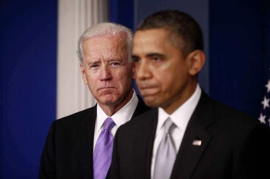 Vice President Joe Biden, left, with President Barack Obama during a news conference at the White House in Washington, Dec. 19, 2012. Obama said Wednesday that he will submit broad, new gun control proposals to Congress no later than January and will commit his office to overcoming political opposition in the wake of the school shooting. (Luke Sharrett/The New York Times) Photo: LUKE SHARRETT / NYTNS