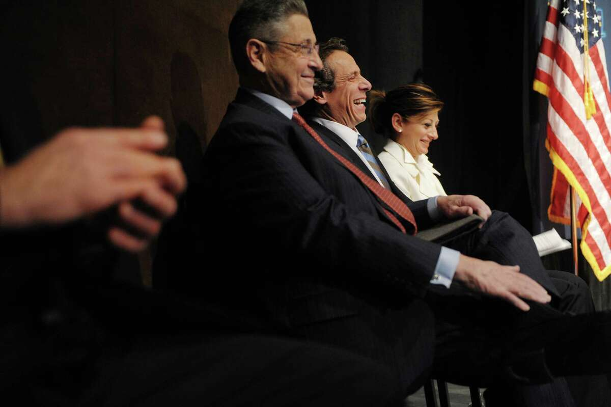 Assembly Speaker Sheldon Silver, left, Governor Andrew Cuomo, center, and CNBC's Maria Bartiromo laugh as they listen to State Senator John DeFrancisco address those gathered for the New York State Regional Economic Development Awards at the Hart Theatre at the Egg on Wednesday, Dec. 19, 2012 in Albany, NY. (Paul Buckowski / Times Union)
