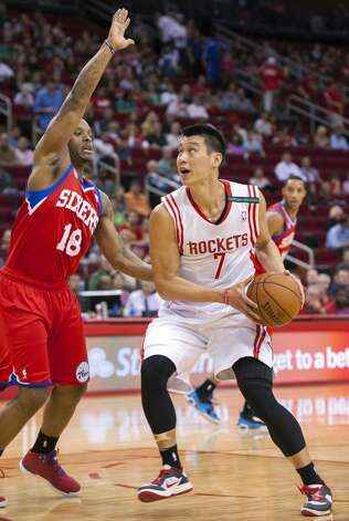 Maalik Wayns of the 76ers defends Rockets point guard Jeremy Lin. (Dave Einsel / Associated Press)