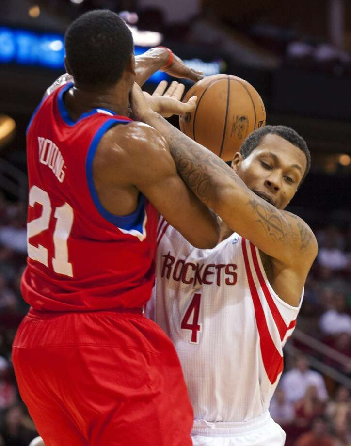 Thaddeus Young of the 76ers defends Greg Smith of the Rockets. (Dave Einsel / Associated Press)