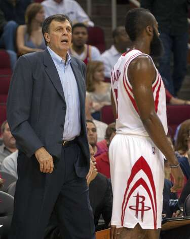 Rockets coach Kevin McHale speaks to guard James Harden. (Dave Einsel / Associated Press)