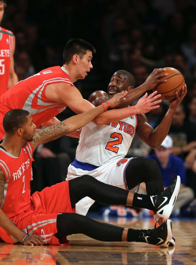 Dec. 17: Rockets 109, Knicks 96Raymond Felton tries to keep the ball as Jeremy Lin and Marcus Morris defend.  (Getty Images)