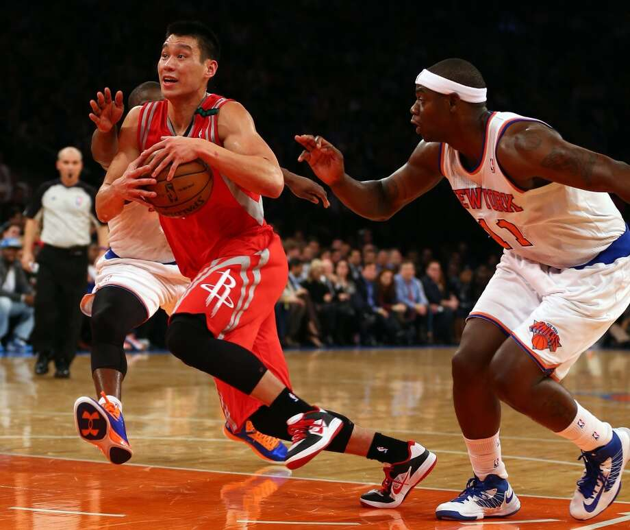 Jeremy Lin of the Rockets heads for the net as Raymond Felton and Ronnie Brewer of the Knicks defend.  (Getty Images)