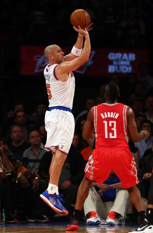 Jason Kidd of the Knicks takes a shot as James Harden defends. (Getty Images)