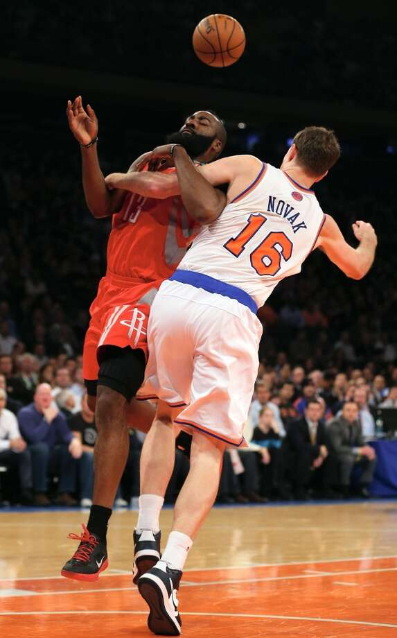 James Harden is fouled by Steve Novak of the Knicks.  (Getty Images)