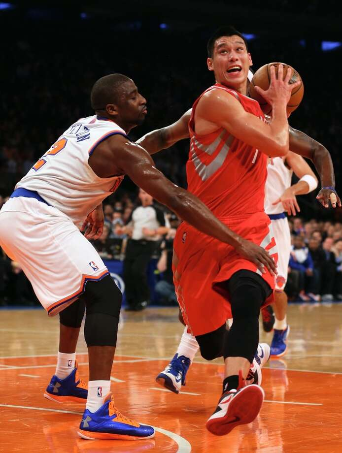 Jeremy Lin of the Rockets tries to get around Raymond Felton of the Knicks. (Getty Images)