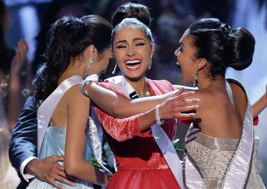 Miss USA, Olivia Culpo, center, reacts with Miss Teen USA, Logan West, as she is announced as the new Miss Universe over first runner-up Miss Philippines, Janine Tugonon, left. Photo: AP