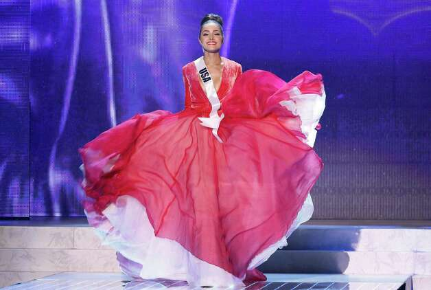 Miss USA, Olivia Culpo, walks on stage during a performance by Australian singer Timomatic. Photo: AP