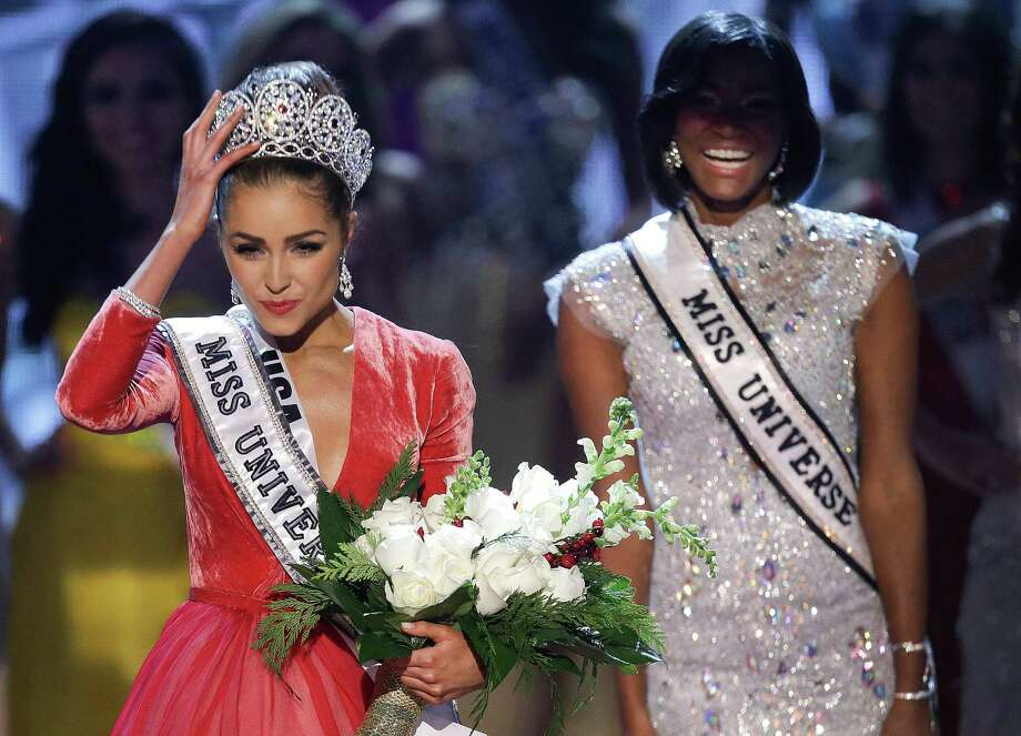 Miss USA, Olivia Culpo, left, adjusts her tiara after being crowned the new Miss Universe as Miss Universe 2011, Leila Lopes, of Angola, right, looks on. Photo: AP