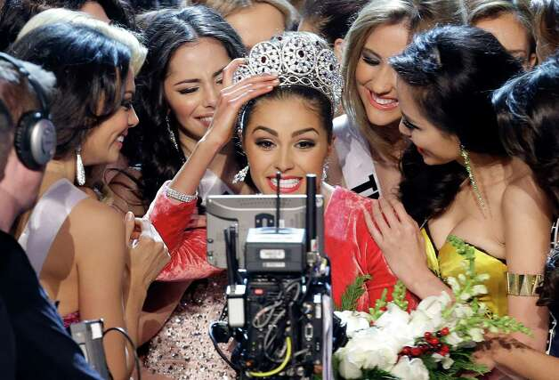 Miss USA, Olivia Culpo, center, smiles for the television camera as she is congratulated by other contestants after being crowned as Miss Universe. Photo: AP