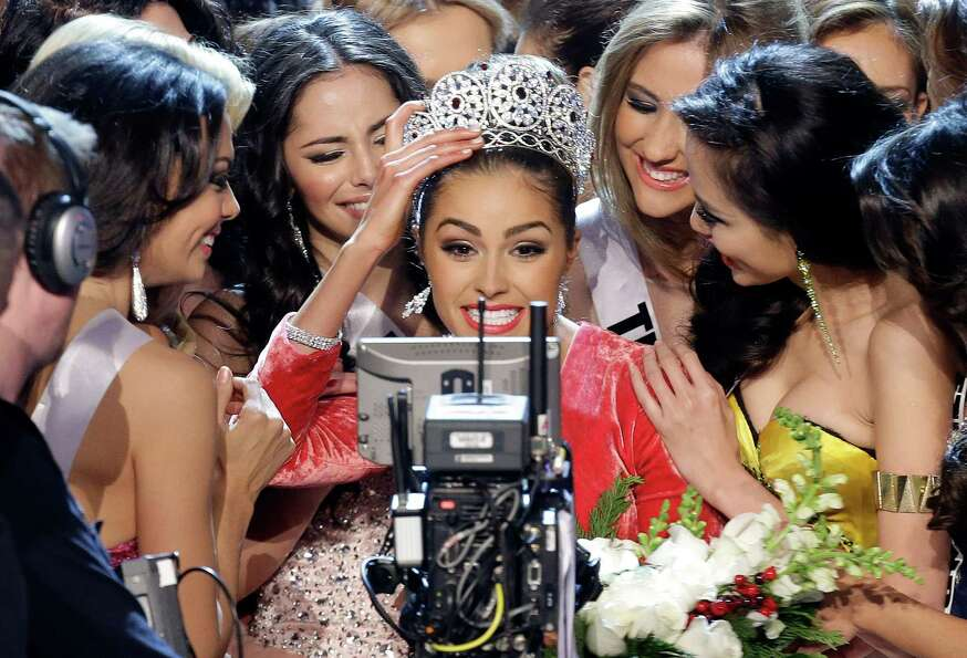 Miss USA, Olivia Culpo, center, smiles for the television camera as she is congratulated by other co