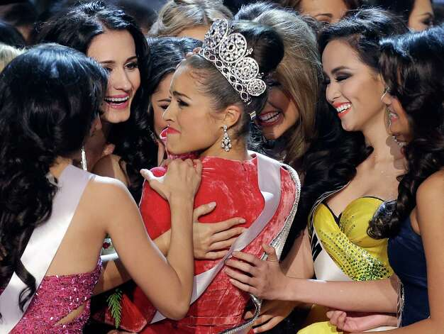 Miss USA, Olivia Culpo, center, is congratulated by other contestants. Photo: AP