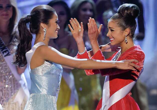 Miss USA, Olivia Culpo, right, reacts and hugs first runner-up, Miss Philippines, Janine Tugonon, after being named Miss Universe. Photo: AP