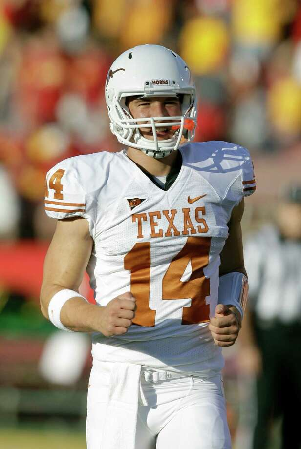 It's out with the new and in the with old as David Ash is back as Texas' starter at quarterback. Photo: Charlie Neibergall, STF / AP2011