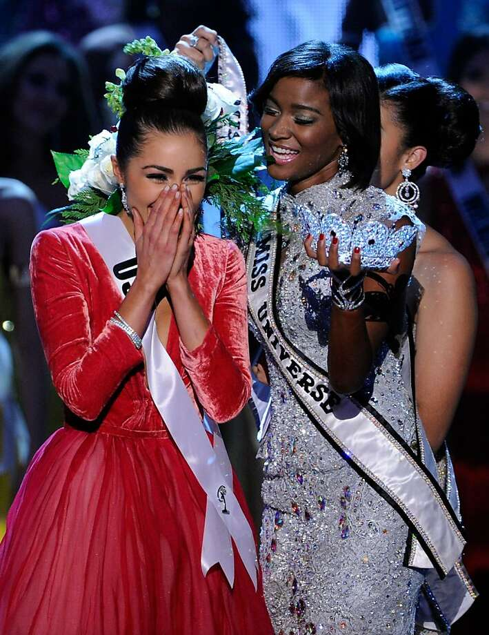 LAS VEGAS, NV - DECEMBER 19:  Miss USA 2012, Olivia Culpo (L), reacts as she is crowned the 2012 Miss Universe by Leila Lopes, Miss Universe 2011, during the 2012 Miss Universe Pageant at PH Live at Planet Hollywood Resort & Casino on December 19, 2012 in Las Vegas, Nevada.  (Photo by David Becker/Getty Images) Photo: David Becker, Getty Images