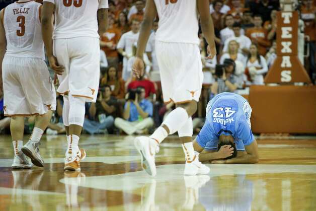 James Michael McAdoo #43 of the University of North Carolina Tar Heels kneels on the court during a timeout against the University of Texas Longhorns on December 19, 2012 at the Frank Erwin Center in Austin. Photo: Cooper Neill, Getty Images / 2012 Getty Images