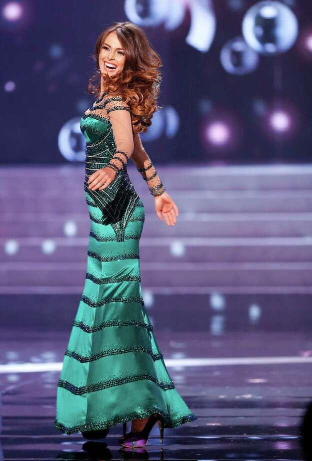 Miss Venezuela, Irene Sofia Esser Quintero, turns on stage during the evening gown competition. Photo: AP