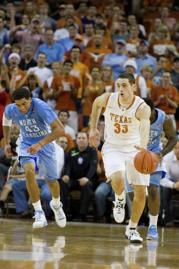 Ioannis Papapetrou #33 of the University of Texas Longhorns brings the ball up the court against the University of North Carolina Tar Heels on December 19, 2012 at the Frank Erwin Center in Austin. Photo: Cooper Neill, Getty Images / 2012 Getty Images