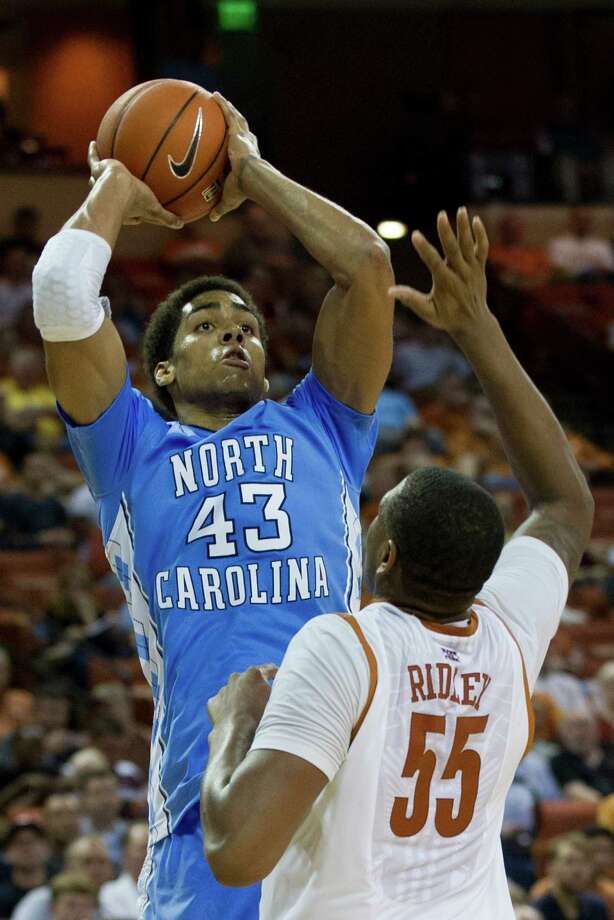 James Michael McAdoo #43 of the University of North Carolina Tar Heels shoots the ball over Cameron Ridley #55 of the University of Texas Longhorns on December 19, 2012 at the Frank Erwin Center in Austin. Photo: Cooper Neill, Getty Images / 2012 Getty Images