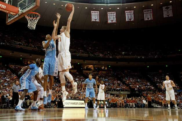 Connor Lammert #21 of the University of Texas Longhorns shoots the ball against the University of North Carolina Tar Heels on December 19, 2012 at the Frank Erwin Center in Austin. Photo: Cooper Neill, Getty Images / 2012 Getty Images