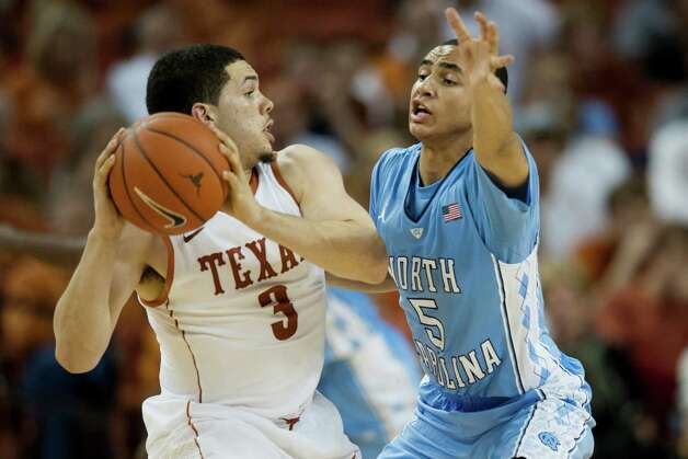 Marcus Paige #5 of the University of North Carolina Tar Heels defends against Javan Felix #3 of the University of Texas Longhorns on December 19, 2012 at the Frank Erwin Center in Austin. Photo: Cooper Neill, Getty Images / 2012 Getty Images