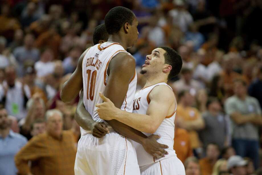 Javan Felix #3 of the University of Texas Longhorns celebrates with teammate Jonathan Holmes #10 against the University of North Carolina Tar Heels on December 19, 2012 at the Frank Erwin Center in Austin. Photo: Cooper Neill, Getty Images / 2012 Getty Images