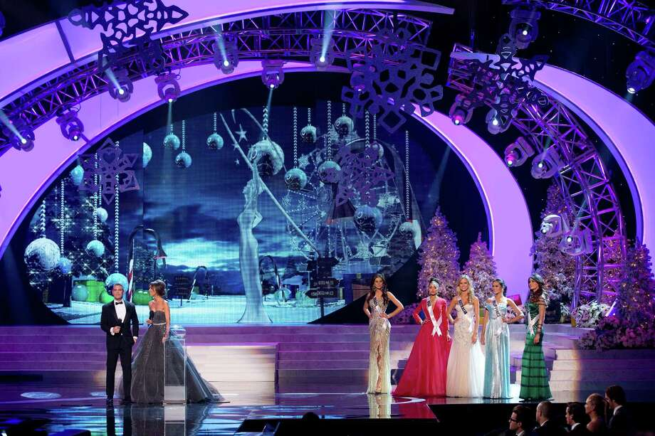 Miss Universe hosts Andy Cohen, left, and Giuliana Rancic, introduce the final round of competition as the five finalists wait to answer questions from the judges. From left, the five finalists were Miss Brazil, Gabriela Markus, Miss USA,  Olivia Culpo, Miss Australia, Renae Ayris, Miss Philippines, Janine Tugonon, and Miss Venezuela, Irene Sofia Esser Quintero. Photo: AP