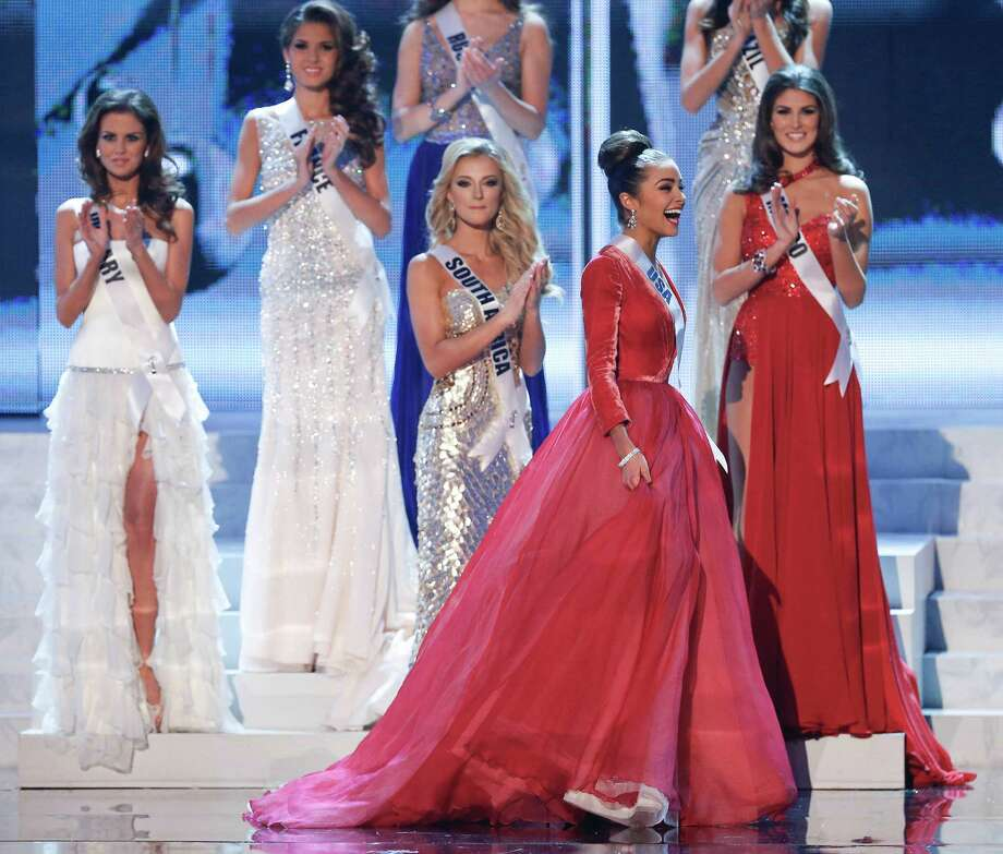 Miss USA, Olivia Culpo, second from right, reacts as she is named as one of the five finalists. Photo: AP