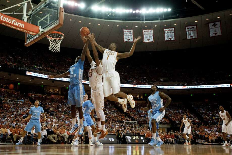 Sheldon McClellan #1 of the University of Texas Longhorns and teammate Cameron Ridley #55 fight for a rebound against Joel James #0 of the University of North Carolina Tar Heels on December 19, 2012 at the Frank Erwin Center in Austin. Photo: Cooper Neill, Getty Images / 2012 Getty Images