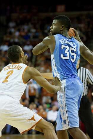 Reggie Bullock #35 of the University of North Carolina Tar Heels is defended by Demarcus Holland #2 of the University of Texas Longhorns on December 19, 2012 at the Frank Erwin Center in Austin. Photo: Cooper Neill, Getty Images / 2012 Getty Images