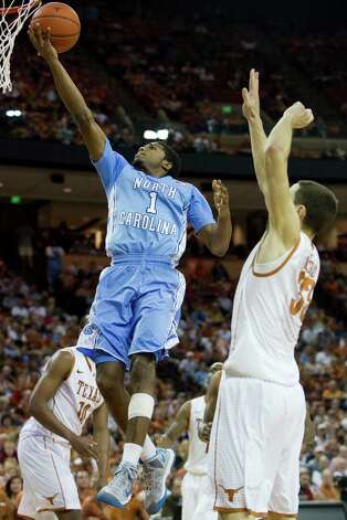 Dexter Strickland #1 of the North Carolina Tar Heels drives to the basket against the University of Texas Longhorns on December 19, 2012 at the Frank Erwin Center in Austin. Photo: Cooper Neill, Getty Images / 2012 Getty Images