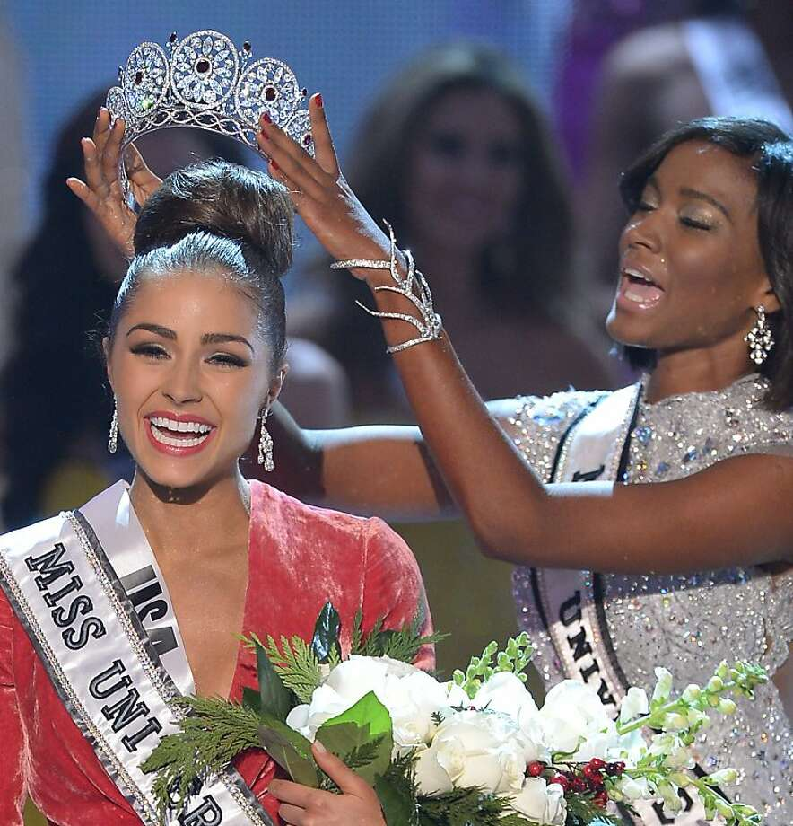 Miss USA, Olivia Culpo (L),  is crowned  Miss Universe 2012 by predecessor, Miss Universe 2011, Leila Lopes (C), at  Planet Hollywood December 19, 2012 in Las Vegas, Nevada.  Miss USA, Olivia Culpo was crowned Miss Universe 2012,  beating out beauties from around the world to claim the coveted title.  The title of first runner-up title went to the contestant from the Philippines, Janine Tugonon.  AFP PHOTO / JOE KLAMARJOE KLAMAR/AFP/Getty Images Photo: Joe Klamar, AFP/Getty Images