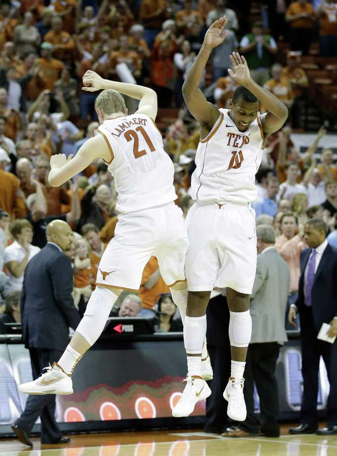 Texas' Connor Lammert (21) and Jonathan Holmes (10) celebrate after they defeated North Carolina in an NCAA college basketball game on Wednesday, Dec. 19, 2012, in Austin, Texas. Texas won 85-67. (AP Photo/Eric Gay) Photo: Eric Gay, Associated Press / AP