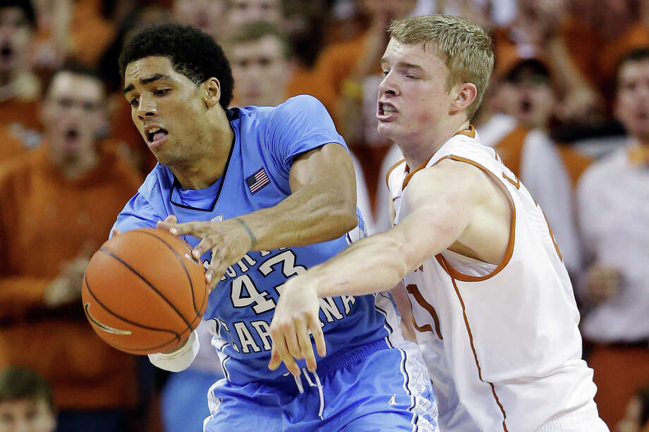 Texas' Connor Lammert, right, pressures North Carolina's James Michael McAdoo (43) during the second half of an NCAA college basketball game, Wednesday, Dec. 19, 2012, in Austin, Texas. Texas won 85-67. (AP Photo/Eric Gay) Photo: Eric Gay, Associated Press / AP